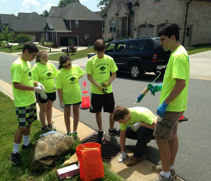 Eagle Scout Troop Marking a Drain